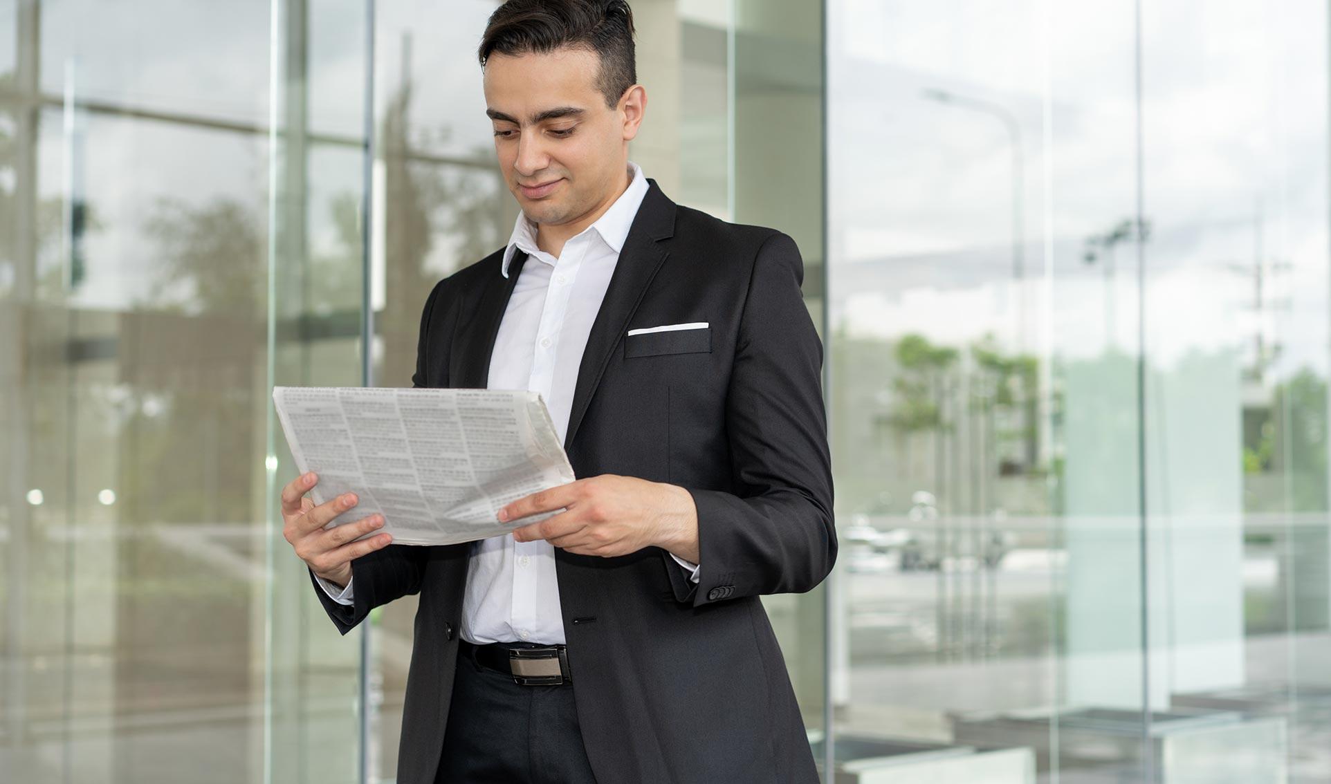 man reads news paper